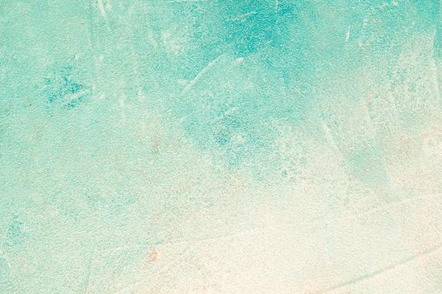 ターコイズ色のコンクリートの壁の背景 無料写真