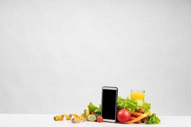 健康野菜と電話コピースペース 無料写真