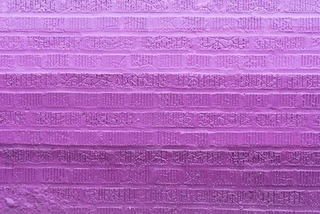 紫レンガの壁の背景 無料写真