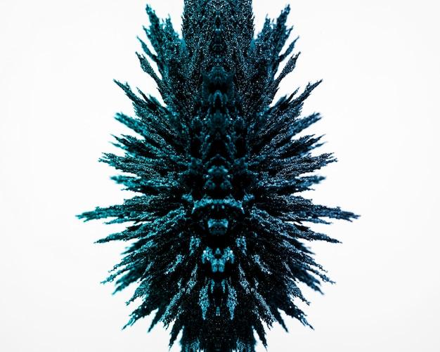 白い背景に分離された青い磁気金属シェービングの設計 無料写真