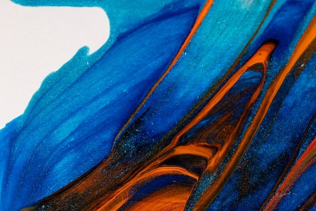 Крупный план смешанной синей и красной краской Бесплатные Фотографии