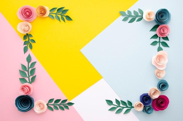花のフレームと多色の背景 無料写真