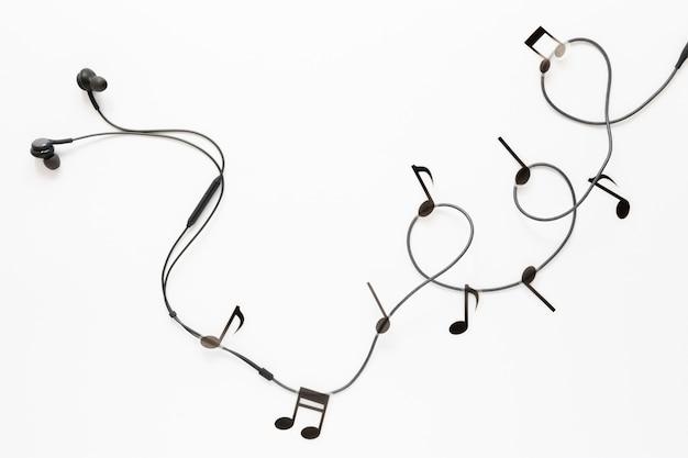 Вид сверху наушники с музыкальными нотами Бесплатные Фотографии