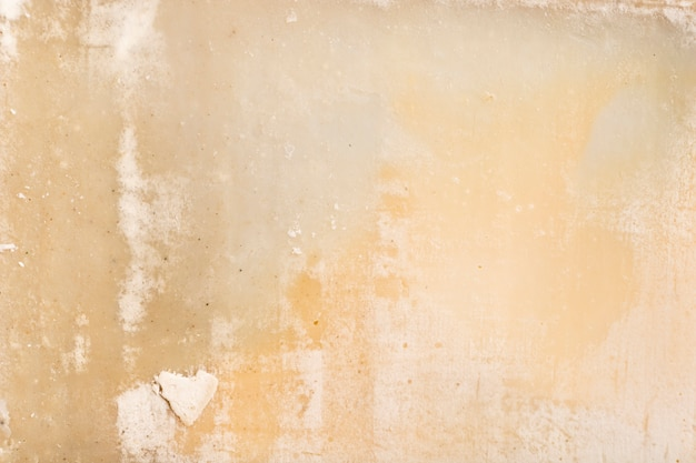皮をむいたコンクリートのヴィンテージの壁の背景 無料写真