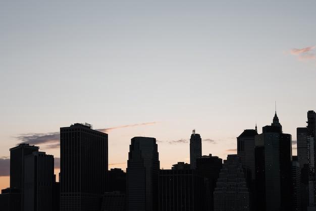 Городской пейзаж нью-йорка на закате Бесплатные Фотографии