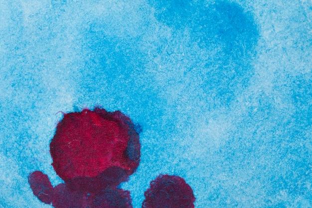 赤い汚れ水彩インク背景と青の抽象 無料写真