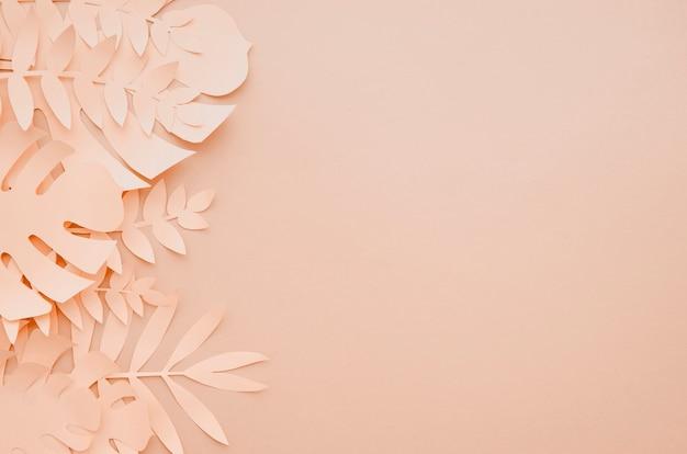 コピースペースを持つ紙カットスタイルで熱帯の葉 無料写真