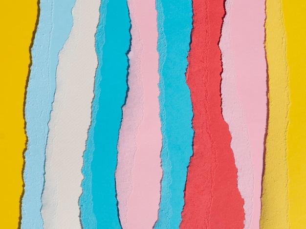 カラフルな垂直破れた抽象的な紙のライン 無料写真