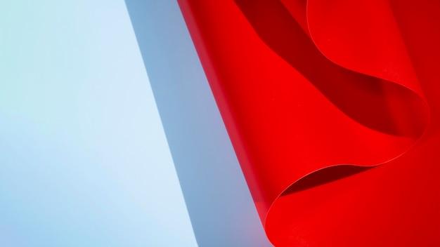 赤の抽象的な湾曲したモノクロ紙 無料写真