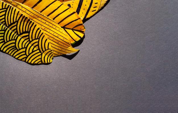 コピースペースの背景を持つ抽象塗装の葉 無料写真
