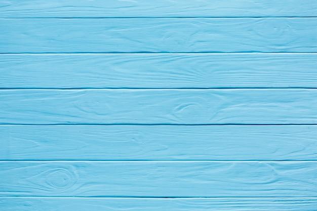 青色に塗られた水平方向の木製ストライプ 無料写真