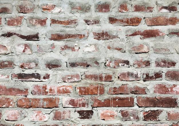 皮をむいたレトロなレンガのテクスチャ背景 無料写真