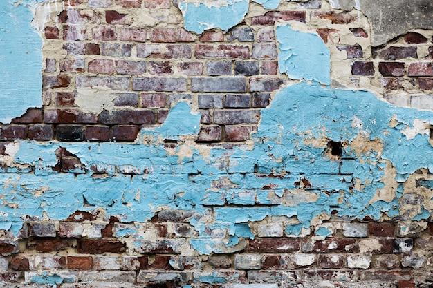 皮をむいた青い塗られたレンガの壁のテクスチャ 無料写真