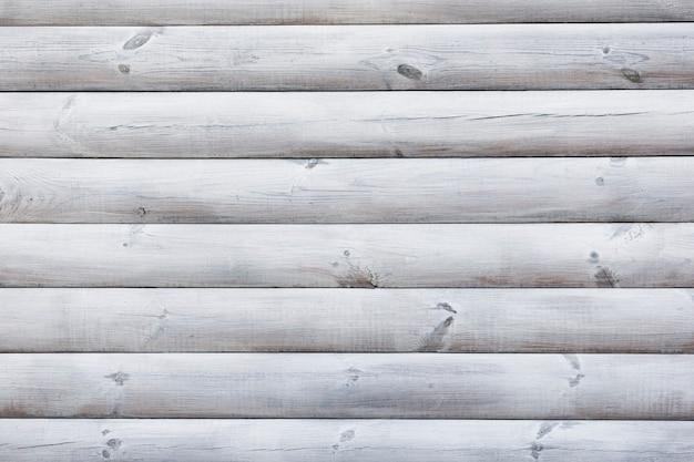 パイルテクスチャ上の白い木の幹 無料写真