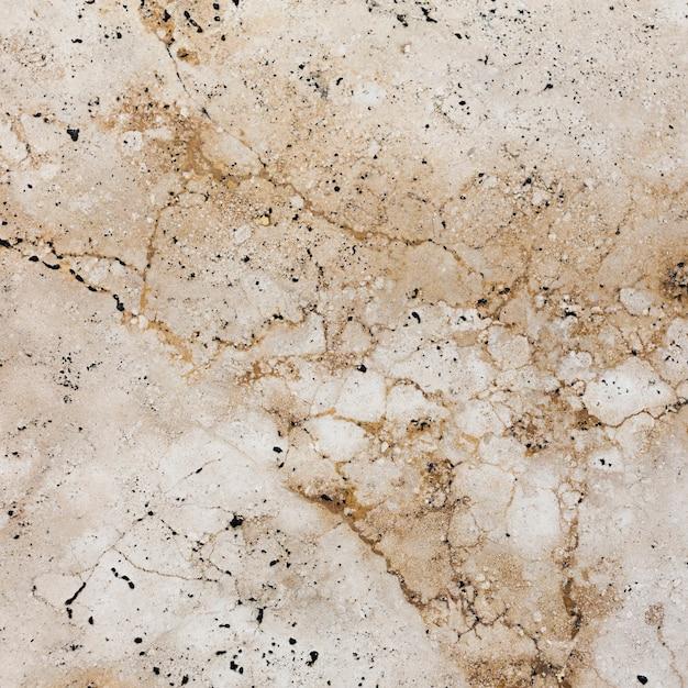 ひびの入ったクリームの花崗岩の背景テンプレート 無料写真