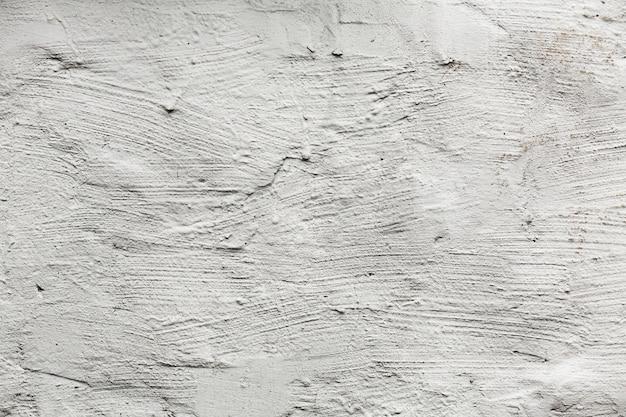 き裂を有する白い塗られた壁のテクスチャ 無料写真