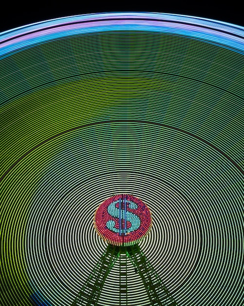 Абстрактные волны неонового света колеса чудо и знак доллара Бесплатные Фотографии