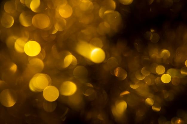 Вид спереди золотые огни в новогоднюю ночь Бесплатные Фотографии