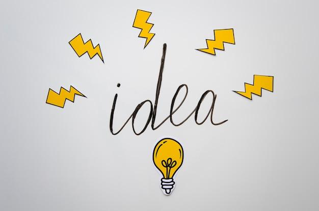 懐中電灯と電球のアイデアレタリング 無料写真