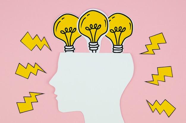 黄金の電球のアイデアコンセプトの頭 無料写真