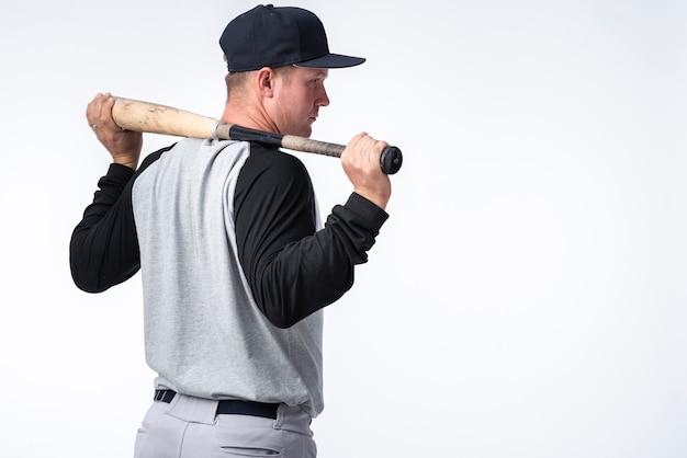 バットで野球選手の背面図 無料写真