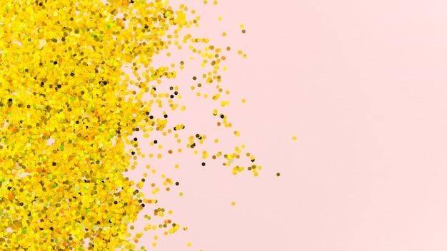 ピンクの背景に抽象的な黄金の輝き 無料写真