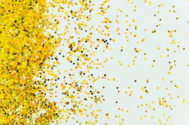 青色の背景に抽象的な黄金の輝き 無料写真
