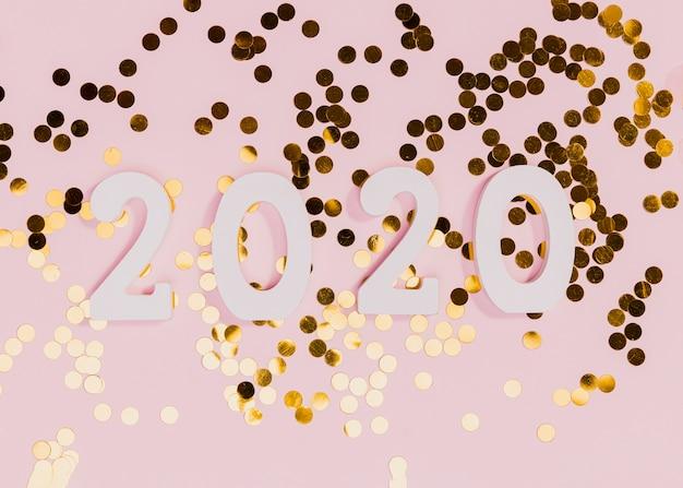 Новый год знаком с золотым конфетти Бесплатные Фотографии