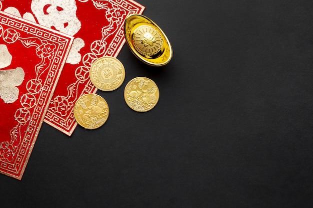 Плоские лежали золотые монеты китайский новый год Бесплатные Фотографии
