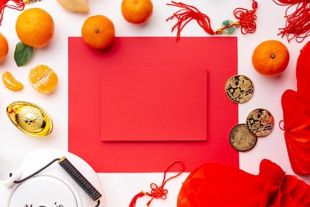 Чайник и мандарины с макетом карты китайский новый год Бесплатные Фотографии
