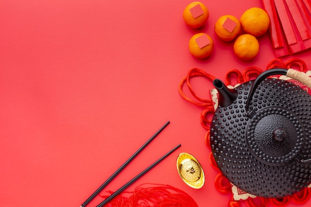 ティーポットと箸中国の旧正月のトップビュー 無料写真