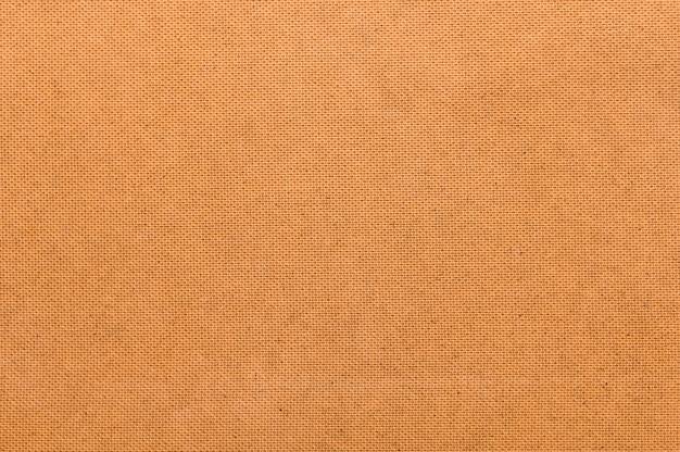 シンプルなオレンジ色の布の背景 無料写真