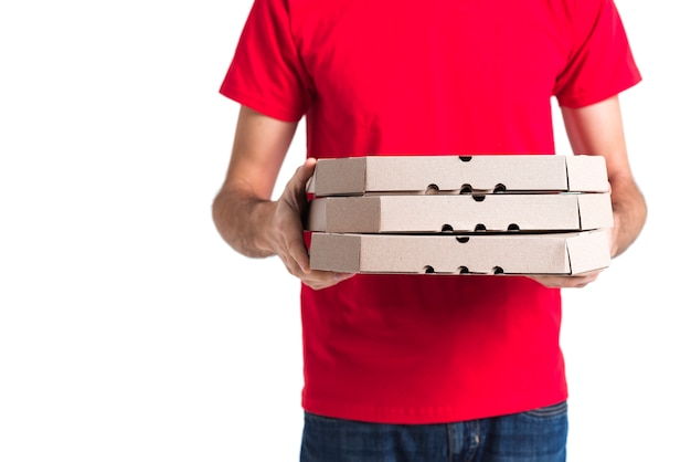 配達用ピザの少年と食料品の箱 無料写真