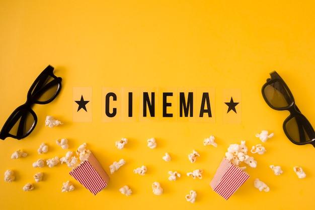 黄色の背景にフラットレイアウト映画レタリング 無料写真
