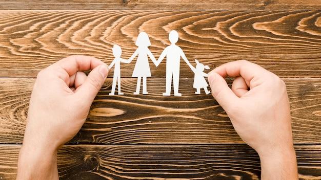 木製の背景に家族の概念のための創造的な配置 無料写真