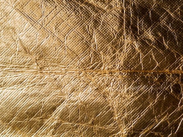 Блестящий желтый лист смял золотую фольгу Бесплатные Фотографии
