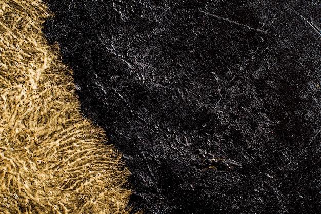 黄金の詳細とスレートの背景 無料写真