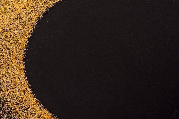 黒い背景に金色のキラキラ輝き 無料写真