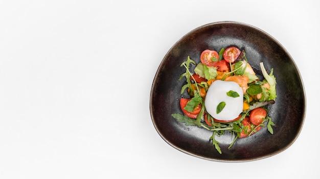 Вкусный салат с помидорами копией пространства Бесплатные Фотографии
