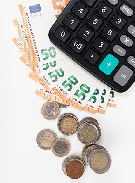 紙幣とコインと電卓 無料写真