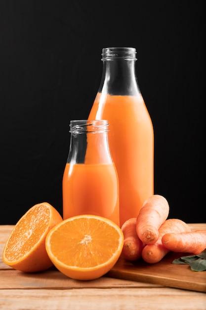 オレンジとニンジンの正面スムージー 無料写真