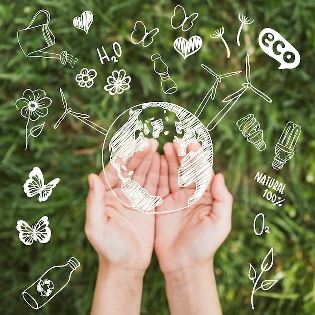 環境コンセプトを持つ手 無料写真