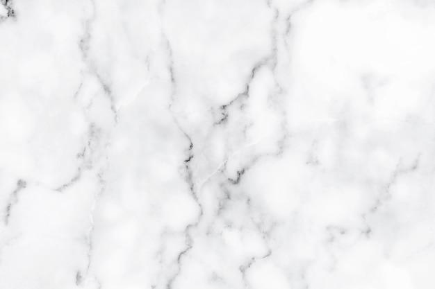 白い大理石の背景テクスチャ天然石パターンデザインアート作品の要約。 Premium写真