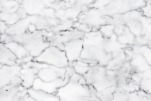 白い大理石の質感と装飾的なデザインパターンアート作品の背景の贅沢。 Premium写真