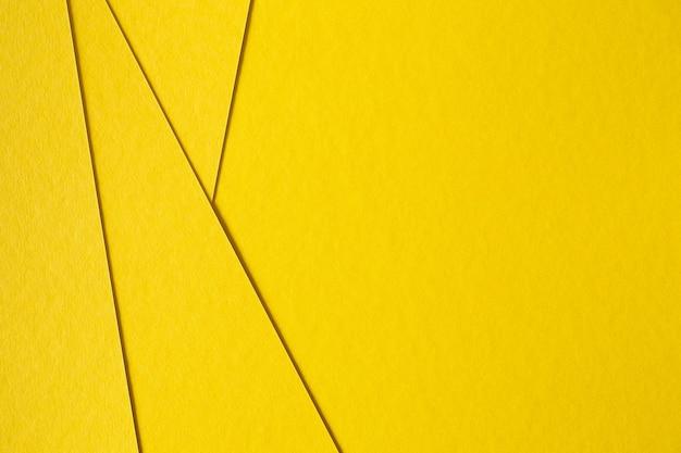 抽象的な黄色板紙の背景 無料写真