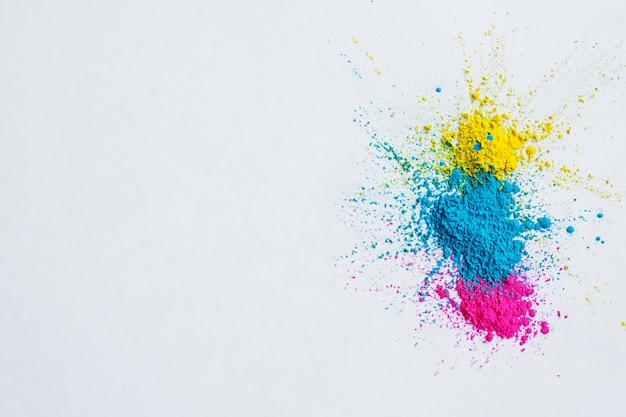 抽象的なパウダー飛び散った背景。カラフルな粉体爆発 無料写真