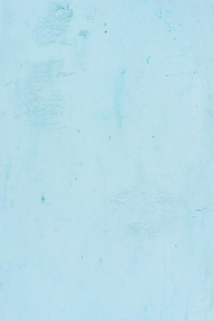 パステルブルーの石膏の背景は印象的で、美しく、そしてシンプルです。 Premium写真