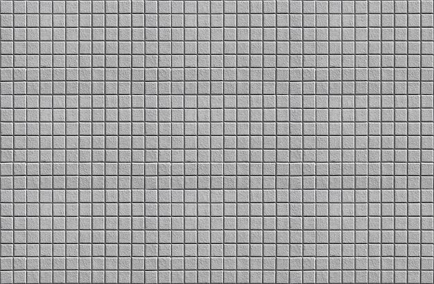 灰色の石積み正方形セメントレンガタイル表面テクスチャデザイン壁の背景。 Premium写真
