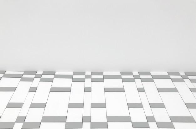 ランダムな正方形のタイル行の壁 Premium写真