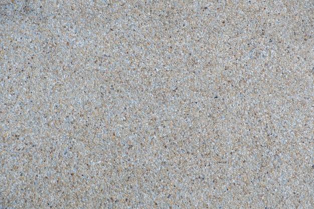 解体された骨材仕上げのコンクリートの壁と床の背景テクスチャ。 Premium写真